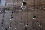 Cairo, Egypt -- Many lamps suspended from the arched ceilings illuminate the Sultan Hassan mosque at night. © Rick Collier / RickCollier.com.