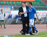 St Johnstone v FC Minsk...01.08.13 Europa League Qualifier at Neman Stadium, Grodno, Belarus...<br /> Manager Tommy Wright with an injured Gary McDonald<br /> Picture by Graeme Hart.<br /> Copyright Perthshire Picture Agency<br /> Tel: 01738 623350  Mobile: 07990 594431