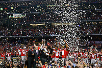 Ohio State Buckeyes head coach Urban Meyer holds up the National Championship trophy after beating Oregon Ducks 42-20 in College Football Playoff Championship game at AT&T Stadium in Arlington, Texas on January 12, 2015.  (Dispatch photo by Kyle Robertson)