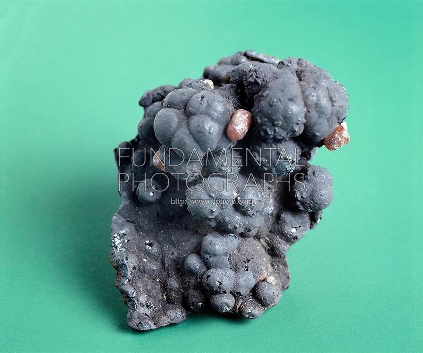 VANADINITE ON GOETHITE<br /> Vanadinite-Pb5(VO4)3Cl, Lead Chlorovanadate<br /> Hexagonal-Hexagonal bipyramidal; Goethite-HFeO2; Hydrogen Iron Oxide; Orthorhombic-Rhombic bipyramidal; Vanadinite is found in secondary mineral deposits(Goethite)
