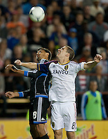Santa Clara, California - Saturday July 14, 2012: Real Salt Lake's Will Johnson and San Jose Earthquakes' Chris Wondolowski jump for the ball during a game at Buck Shaw Stadium, Stanford, Ca     San Jose Earthquakes defeated Real Salt Lake 5 - 0