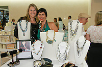 Friend (left and jewelry designer Amy Colvin Nix (right) pose next to Nix & Stones jewely, displayed at The Plaza Hotel's Fashion's Night Out event during New York Fashion Week, September 8, 2011.