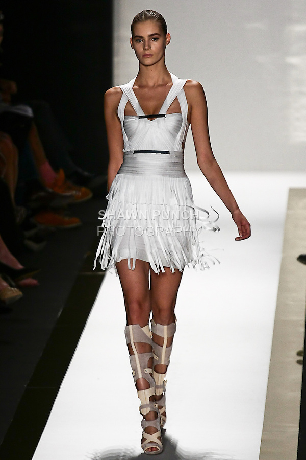 Juju Ivanyuk walks the runway in a white bandage fringe dress, and vapor gladiator boot, by Max Azria for the Herve Leger by Max Azria Spring 2012 fashion show, during Mercedes-Benz Fashion Week Spring 2012.