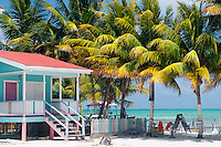 Caye Caulker, Belize, April 2012. Enjoy the beach sand and Caribbean Sea, explore the underwater wonders, try the tasty seafood specials, or experience the laid-back island life. With a population of approximately 1,200 people, the island appeals to visitors looking for a comfortable place to sleep, a white sandy beach, clear aquamarine waters, a variety of bird life, and friendly people. Spend the day snorkeling, fishing, diving, or laying peacefully in your own hammock. In contrast to many other bustling destinations, Caye Caulker has managed to maintain its cozy island appeal.Photo by Frits Meyst/Adventure4ever.com