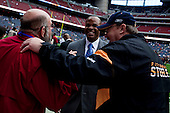 Houston, Texas<br /> October 2, 2011<br /> <br /> Greeting friends on the sidelines of the stadium's field before the game begins, general manager and first as executive vice president, Rick Smith oversees all aspects of football operations. Smith has strengthened Houston's roster through the draft, free agency and several trades at key positions.<br /> <br /> The Houston Texans defeated the Pittsburgh Steelers at the Reliant Stadium 17 to 10.