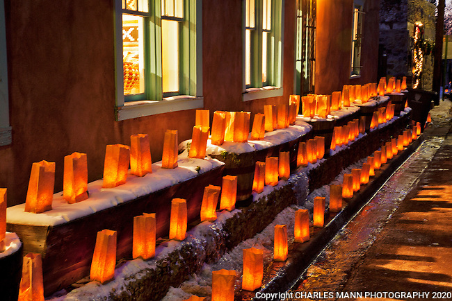 On Christmas Eve thousands of lanterns called farlatios or luminarias line the streets and walls along Canyon Road on the east side of Santa Fe.