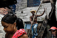 Cubans prepare an Afro-Cuban religious ceremony on the backyard of their house in Santiago de Cuba, Cuba, August 1, 2009. The Palo religion (Las Reglas de Congo) belongs to the group of syncretic religions which developed in Cuba amongst the black slaves, originally brought from Congo during the colonial period. Palo, having its roots in spiritual concepts of the indigenous people in Africa, worships the spirits and natural powers but can often give them faces and names known from the Christian dogma. Although there have been strong religious restrictions during the decades of the Cuban Revolution, the majority of Cubans still consult their problems with practitioners of some Afro Cuban religion.