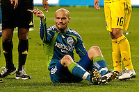 Freddie Ljungberg (seated) of the Seattle Sounders expresses his displeasure in the match against the Columbus Crew at the XBox 360 Pitch at Quest Field in Seattle, WA on May 1, 2010. the Sounders and Crew played to a 1-1 draw.