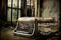 Old typewriter in abandoned building