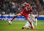 """Victor Machin Perez """"Vitolo"""" of Sevilla FC competes for the ball with Daniel Carvajal Ramos of Real Madrid during their Copa del Rey Round of 16 match between Real Madrid and Sevilla FC at the Santiago Bernabeu Stadium on 04 January 2017 in Madrid, Spain. Photo by Diego Gonzalez Souto / Power Sport Images"""
