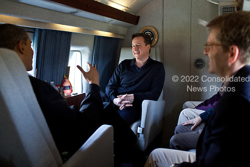 United States President Barack Obama talks with Prime Minister David Cameron of the United Kingdom aboard Marine One en route to Joint Base Andrews, Maryland, before traveling on to Dayton, Ohio, March 13, 2012.  .Mandatory Credit: Pete Souza - White House via CNP