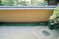 Raked gravel and a stone at the entrance to the Ryogen-in in the Diatokukji complex give a hint of what is to  come inside the gate.