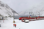 Train staff leaving the railway station at the top of the Oberalp Pass (2044m), connecting Uri with Graub&uuml;den, in the last days before the road to the pass closes for a seven month winter. The rail line remains open.