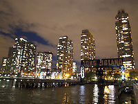 USA. New York City. Long Island City. Night view from Gantry Plaza State Park, a 12-acre riverside oasis that boasts spectacular views on four piers and the rugged beauty of the park's centerpieces - restored gantries. These industrial monuments were once used to load and unload rail car floats and barges; today they are striking reminders of the waterfront's past. Hudson river. 22.10.2011 &copy; 2011 Didier Ruef