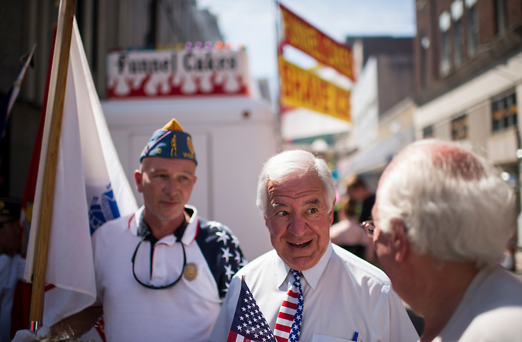 UNITED STATES - JULY 5: Rep. Nick Rahall, D-W.Va., center, speaks with Keith Damron, left, member of the Sons of the American Legion, and Logan Mayor Serafino Noletti at the West Virginia Freedom Festival in downtown Logan, W. Va., on July 5, 2014. (Photo By Bill Clark/CQ Roll Call)