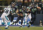 Seattle Seahawks  quarterback Russell Wilson (3) scrambles for a first down against the Carolina Panthers in the NFC Western Division Playoffs at CenturyLink Field  on January 10, 2015 in Seattle, Washington. The Seahawks beat the Panthers 31-17. ©2015. Jim Bryant Photo. All Rights Reserved.