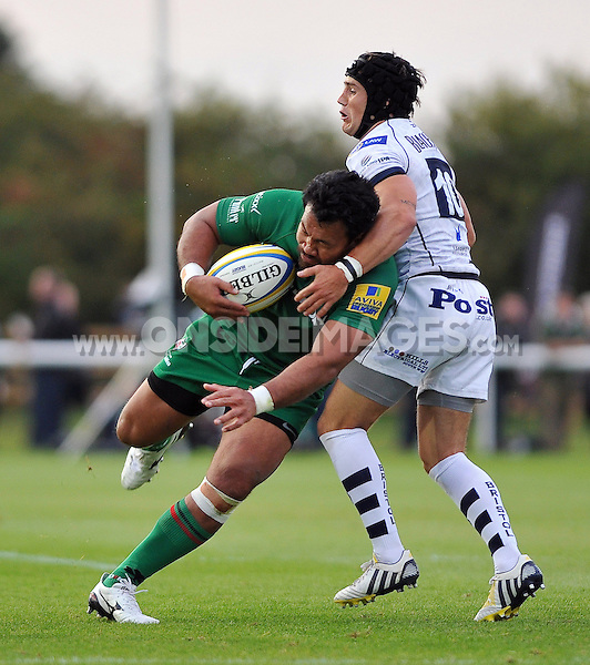 Ofisa Treviranus looks to get past Matthew Morgan. Pre-season friendly match, between London Irish and Bristol Rugby on August 22, 2014 at Hazelwood in Middlesex, England. Photo by: Patrick Khachfe / JMP