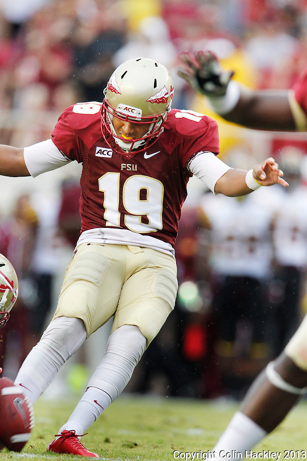 TALLAHASSEE, FLA 9/21/13-FSU-BCC092113CH-Florida State's Roberto Aguayo kicks a point after touchdown against Bethune-Cookman during first half action Saturday at Doak Campbell Stadium in Tallahassee. <br /> COLIN HACKLEY PHOTO