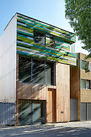 The artist Richard Woods has built a timber house where he can both create and showcase his bold, bright work. The upper part of the larch-clad facade is painted in Wood's bold pattern that mimics the grain of the timber.