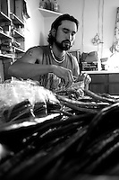 An Alaska Native prepares fish stick packages for delivery to his family.