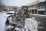 A city front end loader clears snow in Oxford, Miss., on Monday, January 10, 2011.