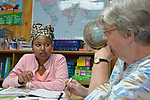Kisanet Araya, an asylum seeker from Eritrea, participates in a class on English as a Second Language at the Posada Providencia, a shelter in San Benito, Texas. Sponsored by the Catholic Sisters of Divine Providence, the shelter provides a safe place for people in crisis from all over the world who are seeking legal refuge in the United States. On the right is her teacher, Maryann Wingert.