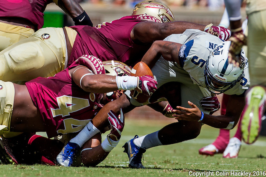 TALLAHASSEE, FLA 9/10/16-Florida State's DeMarcus Walker strips the ball from Charleston Southern quarterback London Johnson during first quarter action Saturday at Doak Campbell Stadium in Tallahassee. The Seminoles recovered the ball. <br /> COLIN HACKLEY PHOTO