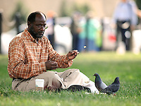 Andre Briscoe of Prince Geroges County, MD, feeds the pigeons at the National Mall in Washington D.C. during his lunch break.