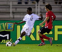 Joseph Amon (12) of the United States puts a cross past Marco Lapenna (7) of Canada during the finals of the CONCACAF Men's Under 17 Championship at Catherine Hall Stadium in Montego Bay, Jamaica. The United States defeated Canada, 3-0, in overtime
