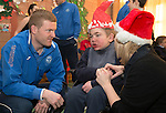 St Johnstone players visit Fairview School in Perth.....19.12.13<br /> Brian Easton pictured with Connor McDougall (15) and Susan Proctor a Support for Learning Assistant.<br /> Picture by Graeme Hart.<br /> Copyright Perthshire Picture Agency<br /> Tel: 01738 623350  Mobile: 07990 594431