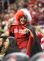 Josh Cole, 13 yrs old, from Columbus, cheer during the second half of the Ohio State against North Florida basketball game, Friday, Nov. 29, 2013, in Columbus, Ohio. (Photo by Terry Gilliam)