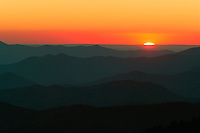 The sun sinks below the mountains at sunset viewed from Clingman's Dome, Great Smoky Mountains National Park