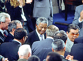 Washington, D.C. - June 26, 1990 -- Nelson Mandela, leader of the African National Congress (ANC) shakes hands with unidentified Members as he departs the Chamber of the United States House of Representatives after addressing a Joint Session of the United States Congress  in Washington, DC on Tuesday, June 26, 1990.  .Credit: Ron Sachs / CNP
