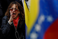 A woman shouts slogans while Venezuela Immigrants supporters of Leopoldo Lopez and Henrrique Capriles take part in a protest against Venezuelas president Nicolas Maduro in Central park, New York. FEB 23, 2014. Photo by Eduardo Munoz Alvarez/VIEWpress