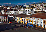 Restored colonial buildings line the street in front of Plaza de San Francisco in Old Town Quito.  The Centro Historico was declared a UNESCO World Cultural Heritage in 1978 because it is one of the largest, least-altered and best preserved historic centers in the Americas.  The twin domes of Iglesia La Compania stand in front of the bell tower of la Catedral and to its right is the dome of Iglesia El Sagrario.  The gothic Basilica del Voto Nacional is seen in the background along with the snowcapped Chimborazo Volcano.