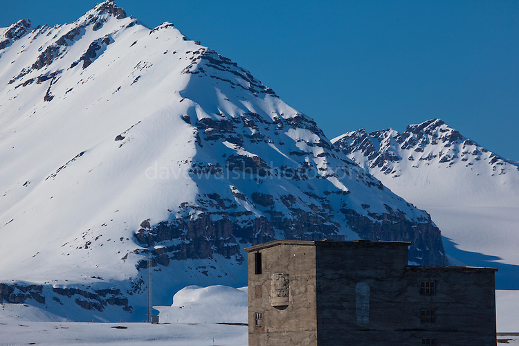 Old coal grading buildings, Ny Alesund, Svalbard. The coal mine, and the settlement were abandonded in 1963, after the Kings Bay Affair - 71 people were killed in accidents in the coal mines in between 1945 and 1963, and the Norwegian government resigned following an investigation. 21 people died in the 1962 accident. The mine closed down, and was later supplanted by the scientific research basis that exists today. Note coffin painted on the wall to mark the deaths.