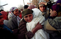 A kashmiri woman hugs one of her relatives before she leaves for Hudge (the sacred journey to Mecca) at Srinagar, Kashmir Valley, India