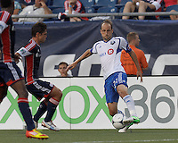 Montreal Impact midfielder Justin Mapp (21) dribbles to avoid oncoming defender. In a Major League Soccer (MLS) match, Montreal Impact defeated the New England Revolution, 1-0, at Gillette Stadium on August 12, 2012.