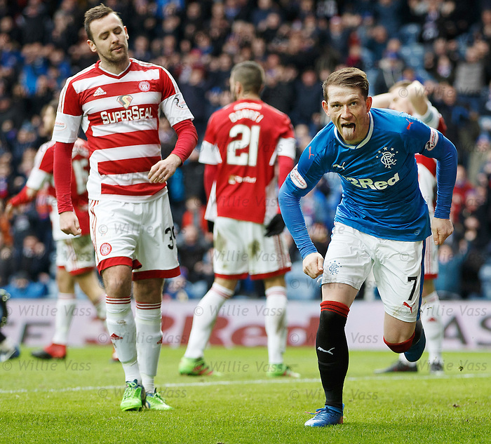 Joe Garner scores goal no 2 and the first of his hat-trick and celebrates