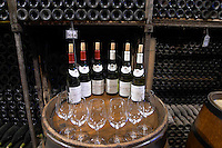 bottles on barrel for tasting and in bins bouchard p & f beaune cote de beaune burgundy france