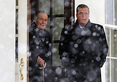 Former United States President George H.W. Bush (L) and his son former Florida Governor Jeb Bush depart the West Wing of the White House after meeting with U.S. President Barack Obama in Washington, D.C. on Saturday, January 30, 2010. .Credit: Alexis C. Glenn / Pool via CNP