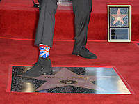 LOS ANGELES, CA. October 25, 2016: Hugh Laurie at the Hollywood Walk of Fame star ceremony honoring British actor Hugh Laurie.<br /> Picture: Paul Smith/Featureflash/SilverHub 0208 004 5359/ 07711 972644 Editors@silverhubmedia.com