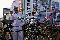 A group of participants dabbed on the forehead with colorful tika dots (a Hindi blessing) and topi hats prepare to start of the 2010 Mumbai Cyclothon festival ride - Bombay/Mumbai - India