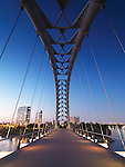 The Humber River Arch Bridge in Toronto during sunset also known as the Humber Bay Arch Bridge or the Gateway Bridge. Toronto, Ontario, Canada.