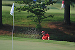 Golfer Sergio Garcia blasts out of a bunker on the 11th hole at the PGA FedEx St. Jude Classic at TPC Southwind in Memphis, Tenn. on Thursday, June 9, 2011.