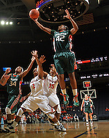 Jan. 6, 2011; Charlottesville, VA, USA; Miami Hurricanes guard Shenise Johnson (42) shoots over Virginia Cavaliers guard Whitny Edwards (2) and Virginia Cavaliers guard Ariana Moorer (15) during the game at the John Paul Jones Arena. Miami won 82-73. Mandatory Credit: Andrew Shurtleff-