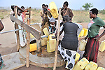 Women in Yei, Southern Sudan, fight for access to water from a well provided by the United Methodist Committee on Relief (UMCOR).