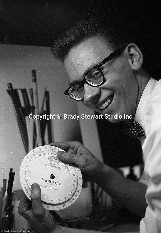 Pittsburgh PA:  Bob Pavuchak posing for a photograph that was used in the Brady Stewart Studio advertisement at Ketchum McLeod and Grove offices - 1957.  Bobby worked for Brady Stewart Studio from 1957 to 1965 when he left to pursue an award winning career at the Pittsburgh Press newspaper.