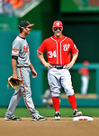 20 May 2012: Washington Nationals outfielder Bryce Harper has a word with Baltimore Orioles shortstop J.J. Hardy during a game against the Baltimore Orioles at Nationals Park in Washington, DC. The Nationals defeated the Orioles 9-3 to salvage the third game of their 3-game series. Mandatory Credit: Ed Wolfstein Photo