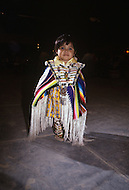 May 6th to 13th, 1985 in Navajo Reserve, AZ. Navajo women wearing traditional ornaments and modern costumes. Photographed during the traditional Pow Wow dance performance.